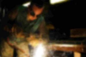 Man welding | Walker cutting