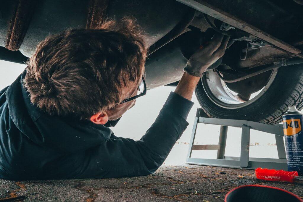 Technician fixing car